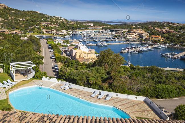 May 24, 2019: Italy, Sardinia, Sassari Province, Costa Smeralda, Porto Cervo, View of Hotel Luci di la Muntagna swimming pool and marina