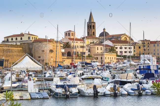 June 11, 2019: Italy, Sardinia, Alghero, View of harbour and the historical center