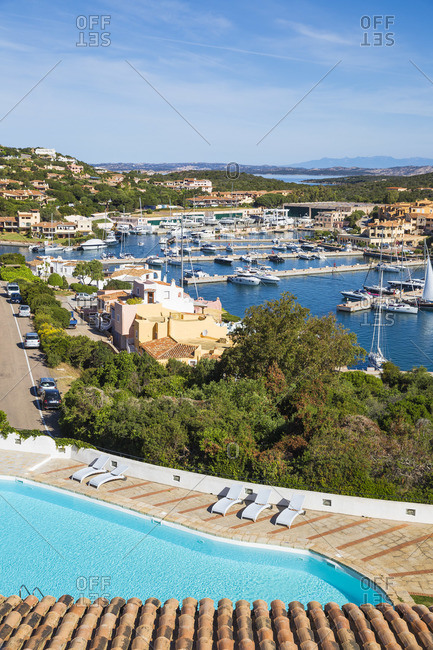 May 24, 2019: Italy, Sardinia, Sassari Province, Costa Smeralda, Porto Cervo, View of Hotel Luci di la Muntagna swimming pool and marina