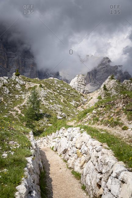 Italian Dolomites, 1st world war tracks, cloudy sky. Veneto, Italy