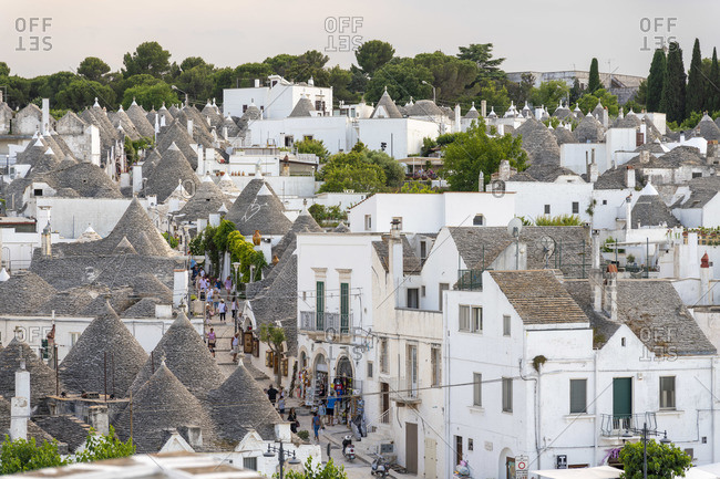 June 20, 2019: High view of Traditional Trulli houses and rooftops in Alberobello, Puglia, Italy, Europe
