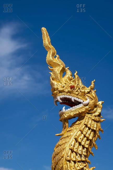 Golden dragon statue at Dhart Zom Doi Kabar Aye Pagoda near Kengtung, Mong La, Mong La Township, Kengtung District, Shan State, Myanmar