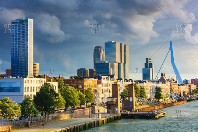 November 20, 2019: View of Rotterdam skyline with Erasmus bridge at sunset, Holland/Netherlands