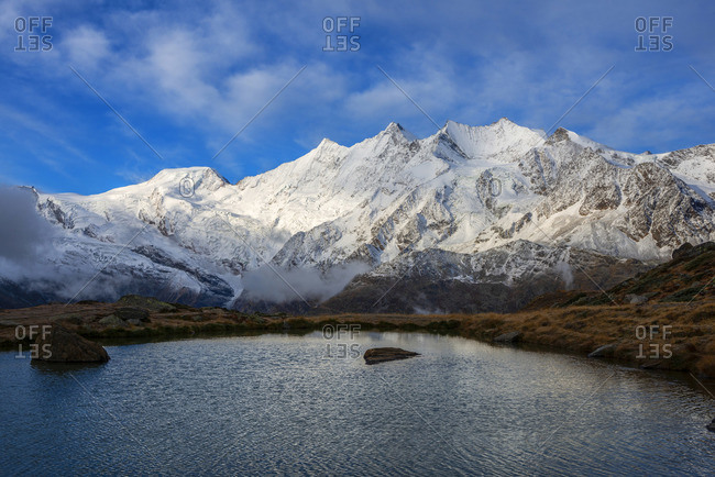 Mountain lake at Kreuzboden with Mischabel mountain range, Saas-Grund, Valais, Switzerland