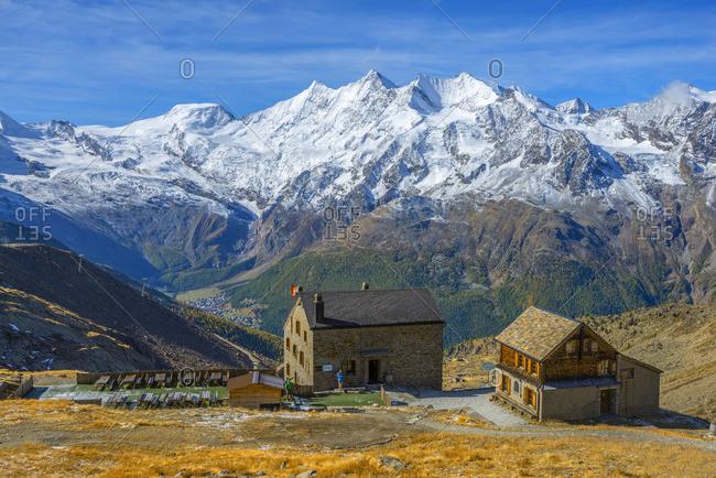 October 10, 2019: View on the Weissmies mountain hut with Saas-Fee and the Mischabel mountain range, Saas-Grund, Valais, Switzerland