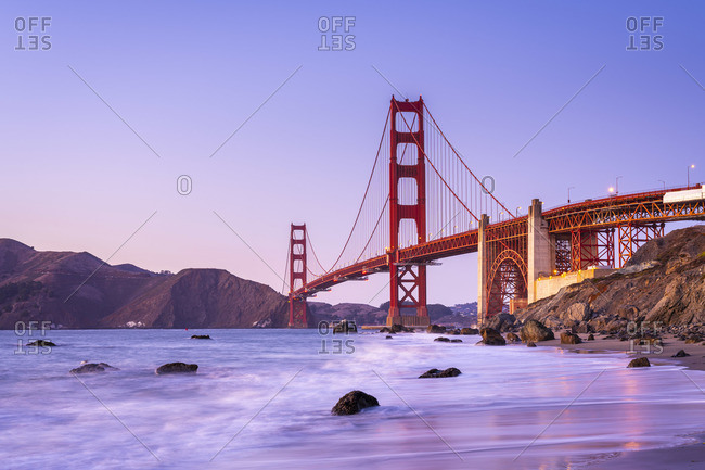 Famous Golden Gate Bridge over bay against blue sky during sunset, San Francisco, San Francisco Peninsula, Northern California, California, USA