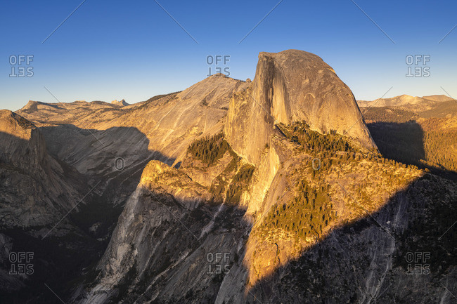 Scenic view of Half Dome granite rock formation at Yosemite National Park during sunset, Sierra Nevada, Central California, California, USA