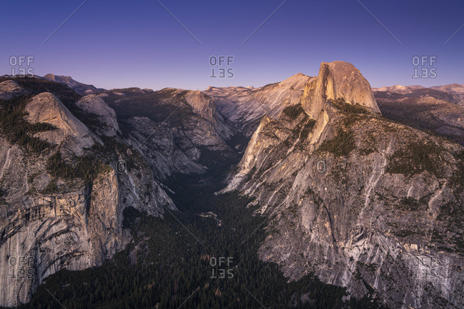 Scenic view of Half Dome granite rock formation at Yosemite National Park after sunset, Sierra Nevada, Central California, California, USA