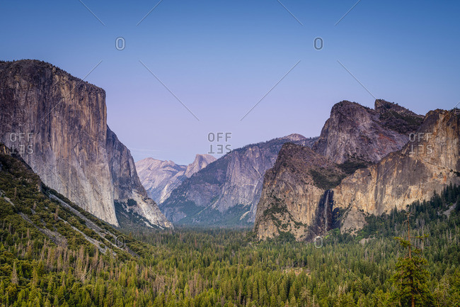 Idyllic shot of alpine forest amidst rocky mountains at Tunnel View, Yosemite National Park, Sierra Nevada, Central California, California, USA