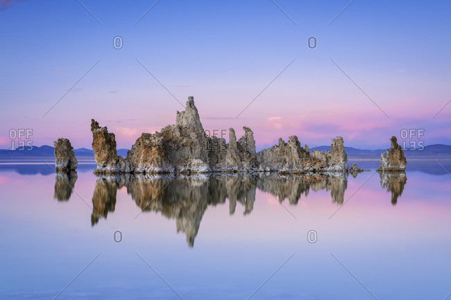Reflection of rock formation in South Tufa on Mono Lake against blue sky at sunset, Mono County, Sierra Nevada, Eastern California, California, USA