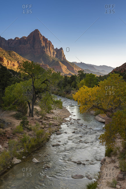 Scenic view of The Watchman mountain from Virgin river at sunset, Zion National Park, Utah, USA