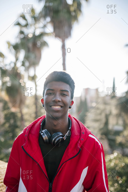 Portrait of black teenage boy with headphones
