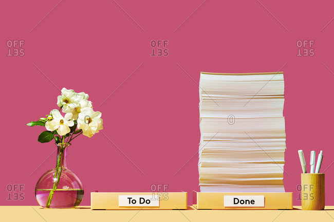 Organized Desk with Stack of Paper