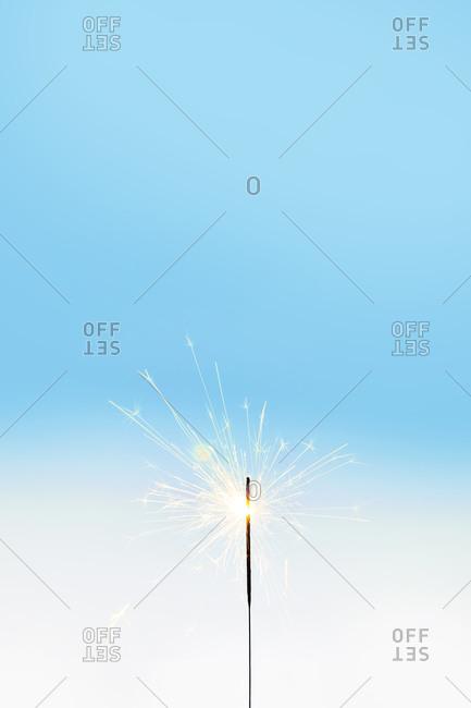 Single Sparkler on Plain Background
