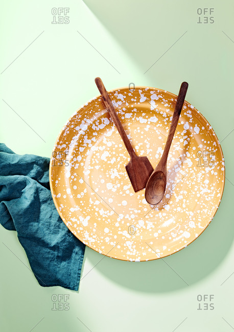 Speckled Plate with Wooden Utensils