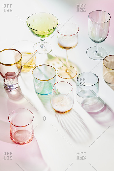 Colorful transparent vintage Glassware on a pink background