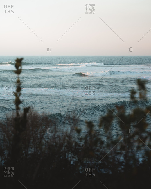 Atlantic ocean waves during sunset in France