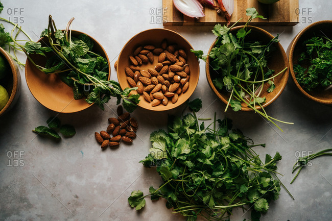 Bowls of almonds and various greens
