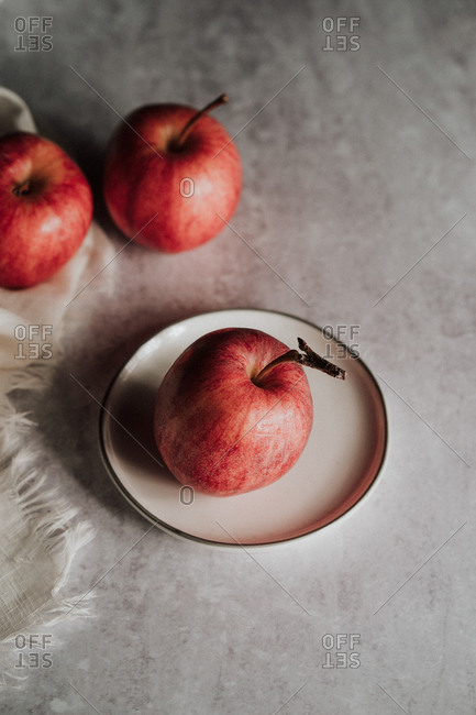 Freshly washed apples and small white plate