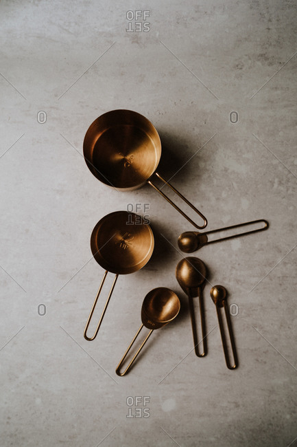 Gold measuring cups on kitchen counter