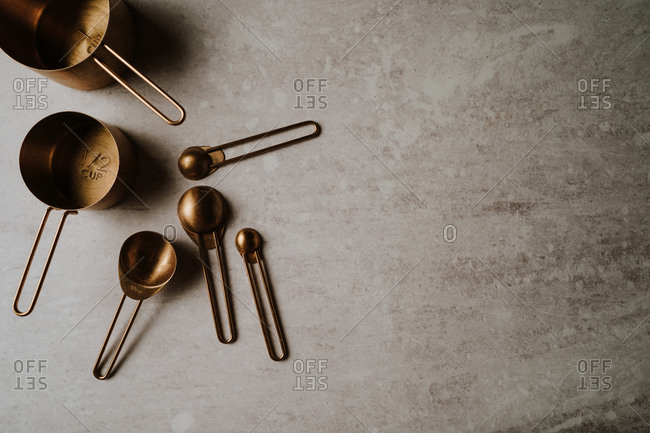 Gold measuring cups on countertop