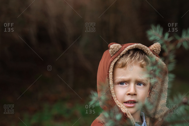 Little boy with blue eyes wearing a jacket with fox ears