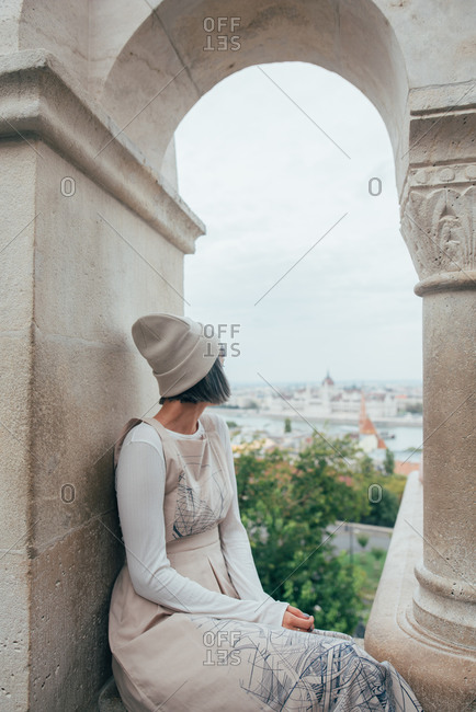 Young woman with dyed gray hair looking over the city in Budapest, Hungary