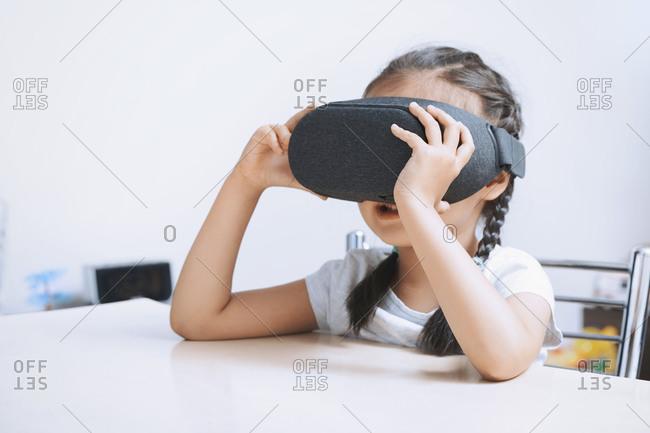 Preschool girl using virtual reality headset