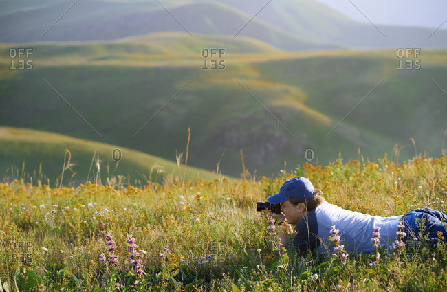 Man outdoors taking photo with his vintage film camera