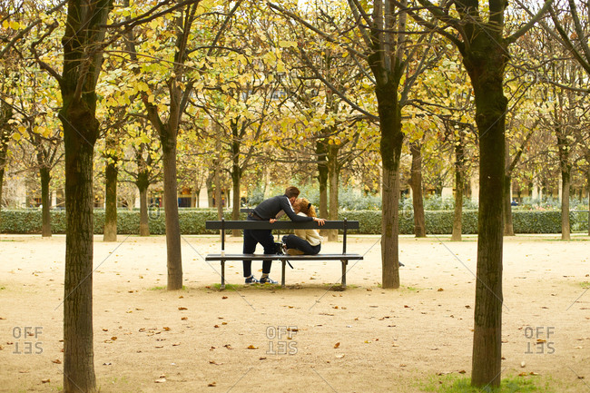 Paris, France - 9 November 2019: Romantic couple kissing at Palais Royal Garden