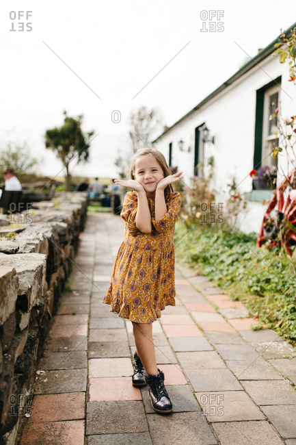 Happy little girl posing while on vacation in Ireland