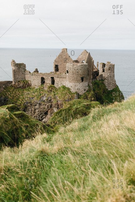 Remains of the Dunluce Castle on the coast of Northern Ireland