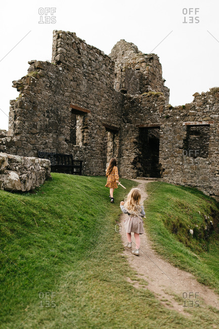 Two girls walking up path to the Dunluce Castle in Northern Ireland