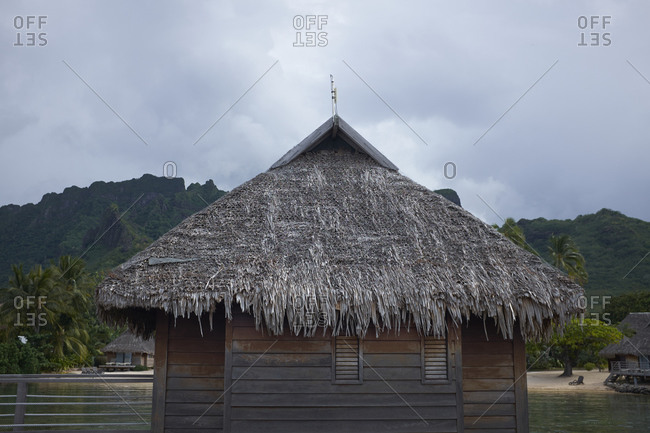 Thatched roof bungalow on the coast of Mo'orea