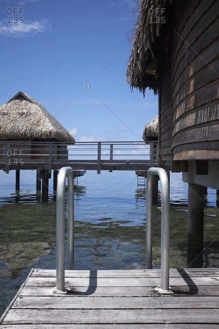 Dock attached to a thatched roof bungalow on the coast of Mo'orea