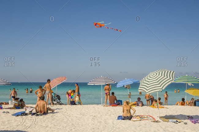 Italy, Tuscany, Rosignano Marittimo - August 20, 2008: People enjoying summer day at a beach with white sand