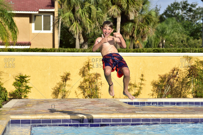 A boy has fun on vacation at the hotel pool