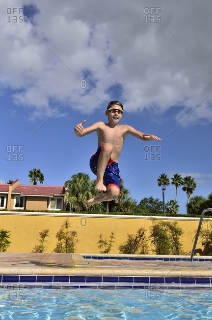 Boys play in a pool on vacation in florida