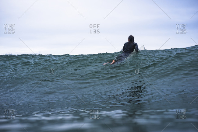 Woman looking for waves
