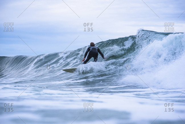 Young man surfing on overcast day