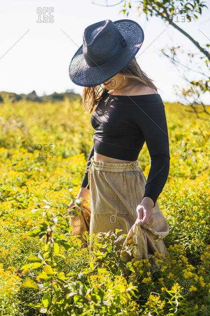 Bohemian vintage prairie cowgirl exploration of nature preserve field