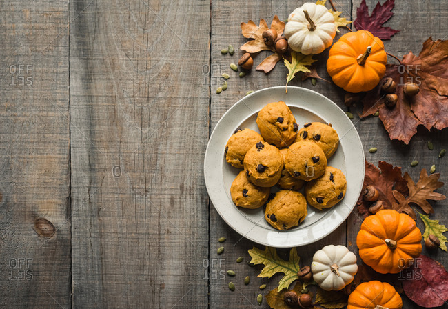 Pumpkin chocolate chip cookies on a plate with fall decor from above.