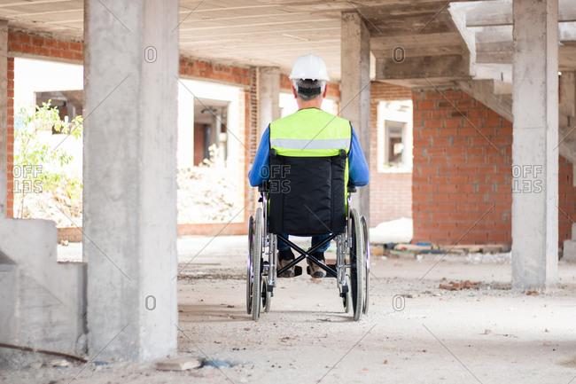 A wheelchair construction technician supervising a construction site