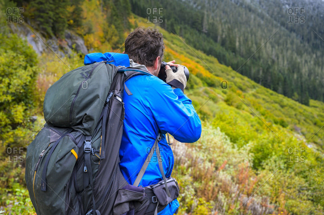 Hiker taking photograph in the mountains