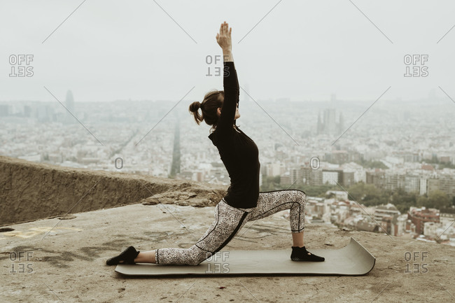 Young woman practicing yoga, asana with hands together.