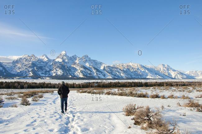 Man walks in the snow in Grand Teton National Park