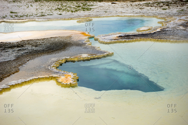 Doublet pool features blue water and colorful sinter geyserite mats