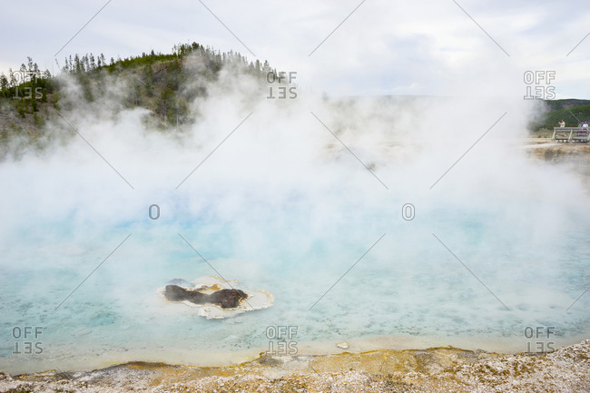 Excelsior geyser with a large cloud of hot mist, midway geyser basin
