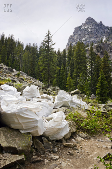 Boulders in bags on the side of a mountain hiking trail