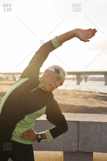 Caucasian man doing bending exercise